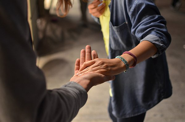 virtue is universal | people holding hands